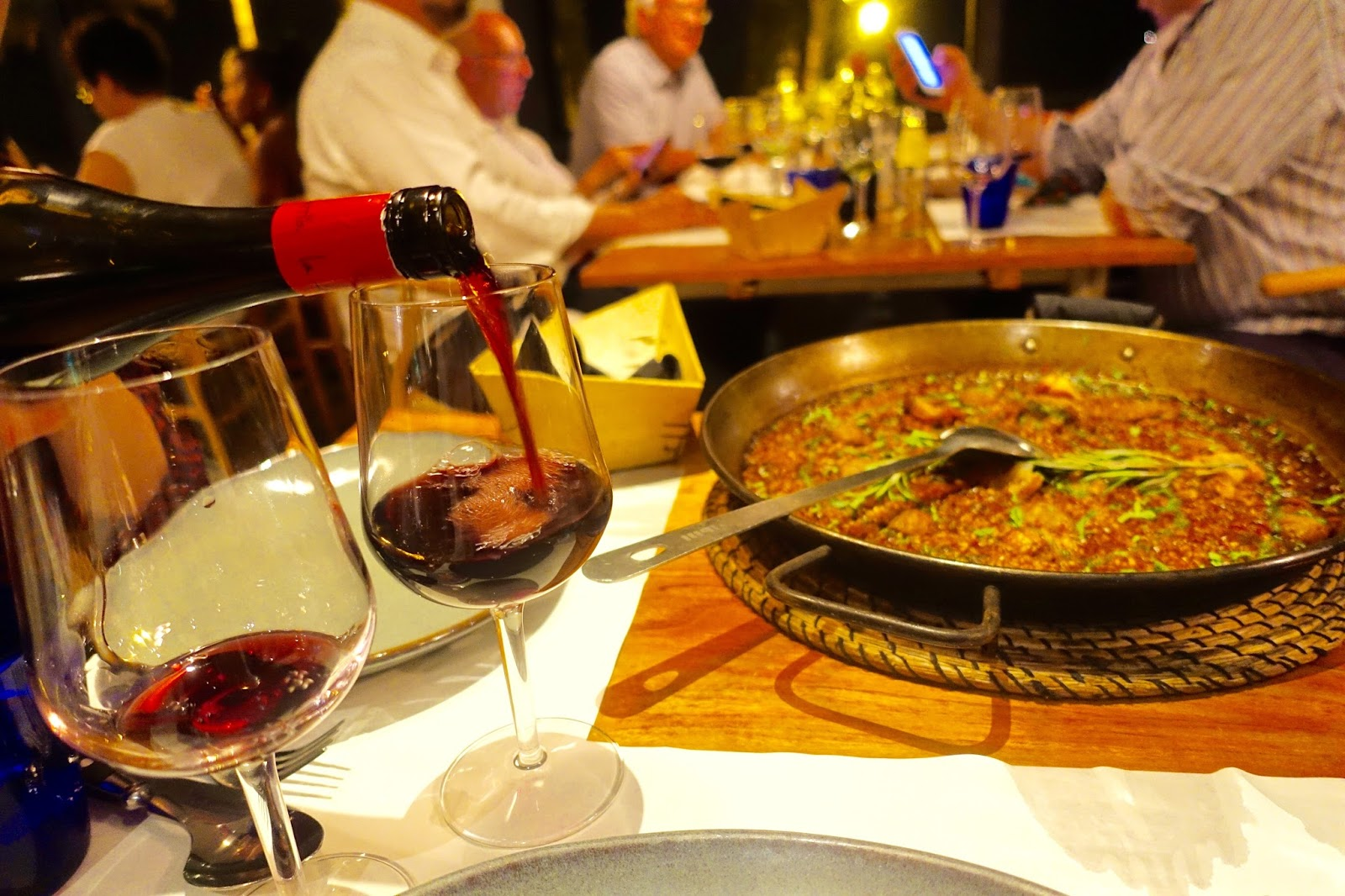 meat paella and red wine at barraca