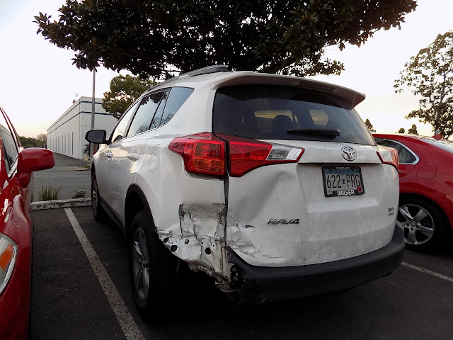 Collision damage on 2015 Toyota RAV4 before repairs at Almost Everything Auto Body.
