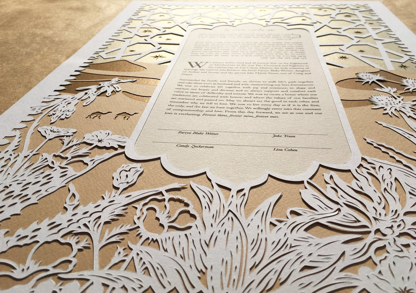 Handmade modern papercut ketubah designed & cut by Woodland Papercuts for a Jewish wedding celebration in the theme of Arabian Nights - Golds, Sand Dunes, Camels and Cacti.