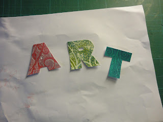Letters A, R and T cut from patterned card