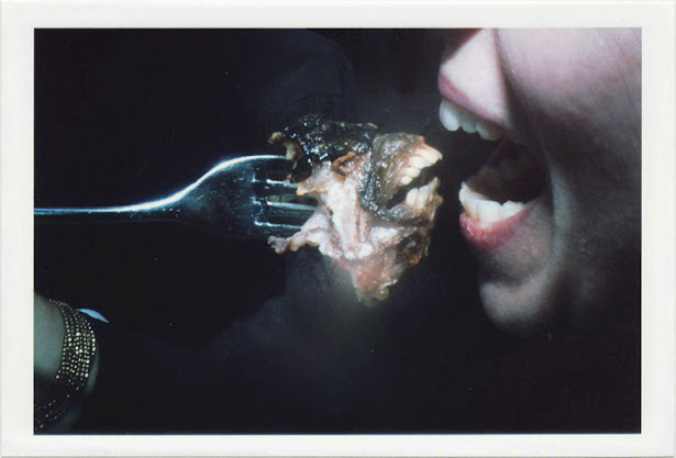 dirty photos - fumus - girl eating fishes' mouth with teeth