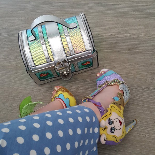 blue polka dot dress with Miss Piggy shoe and silver treasure chest handbag