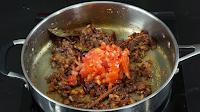 adding-tomato-for-kadai-masala
