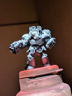 Space Marine terminator primed flat black with a white highlight airbrushed.