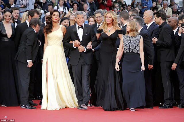 Amal stood out on the red carpet as she posed with her husband, actress Julia Roberts and director Jodie Foster