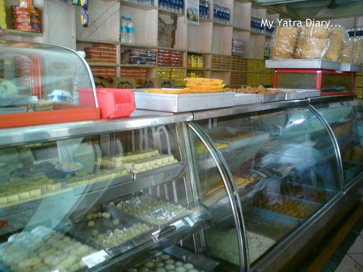 An array of sweets stacked up at Bharti Food, a sweetmeat Vrindavan restaurant