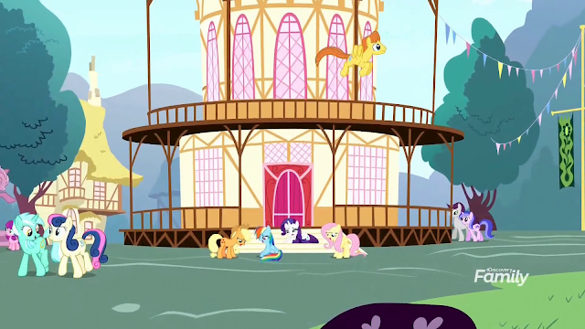Ponyville town-hall with Mane 6 in front. Background ponies walk and fly by.