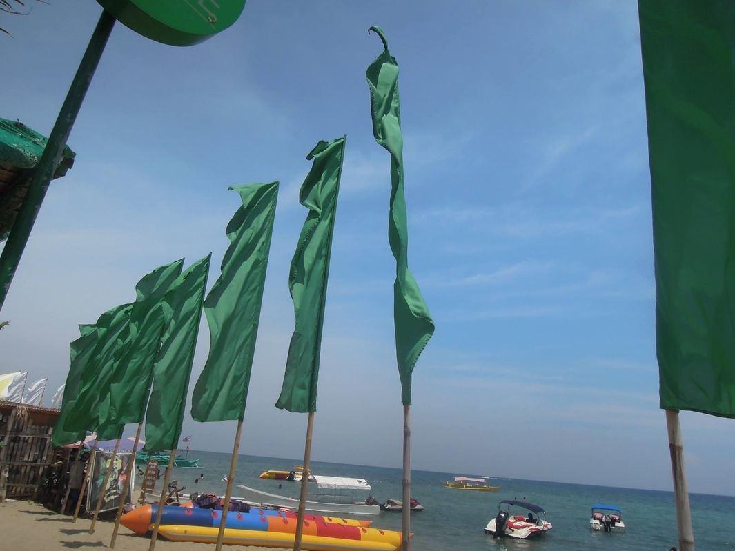 Flags at Paseo Verde Beach Resort