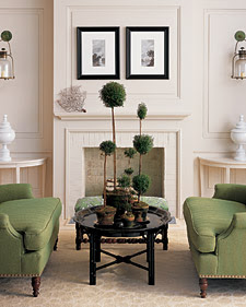 These zen garden trees compliment the green couches in this sitting room