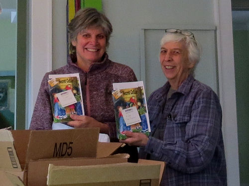 author Joan H. Young and cover artist Linda J. Sandow holding books