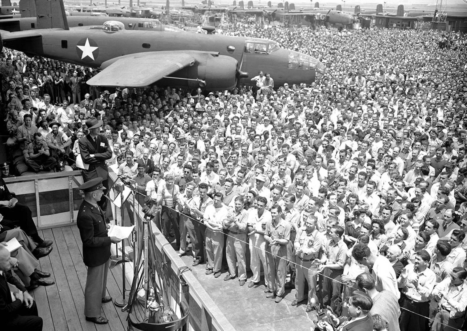 Lt. Col. James Doolittle, who led the April, 1942 air raid on Tokyo, addresses a throng of aircraft workers at the North American Aviation plant on June 1, 1942. He said that