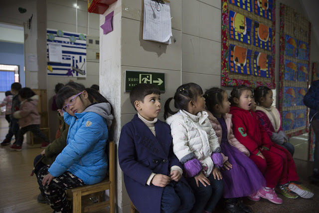 Alo-baidi Yousif (M), 4, an Iraqi child born in China, sits with other children in a kindergarten in Yiwu, Zhejiang Province, China 11 January 2017. In 2016, Yiwu issued 9,675 people with temporary residence permits, nearly half of them from war-torn countries including Iraq, Yemen, Syria and Afghanistan. To match story CHINA-MIGRANTS/MIDEAST Thomson Reuters Foundation