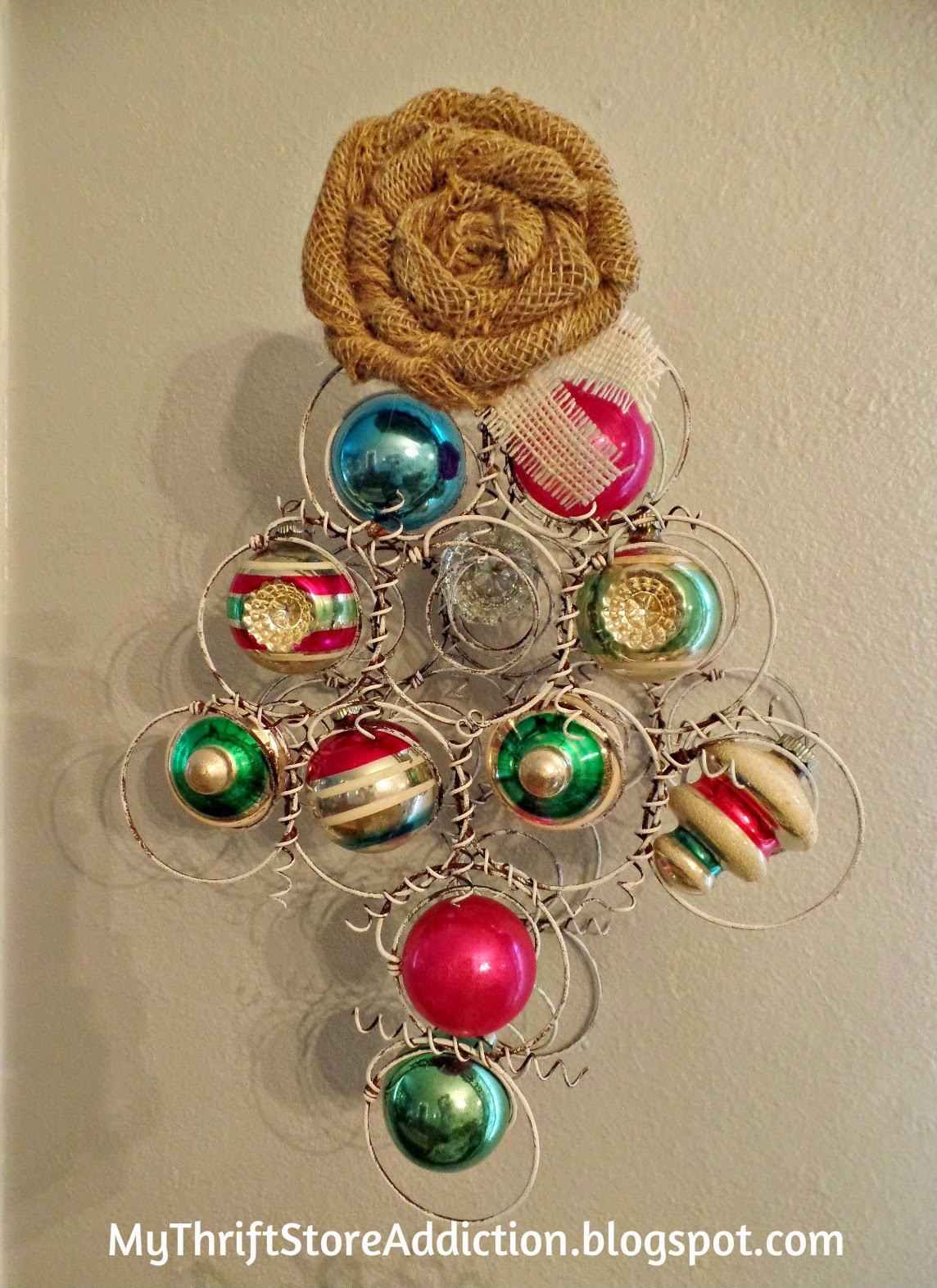 Repurposed bedspring and vintage ornament tree