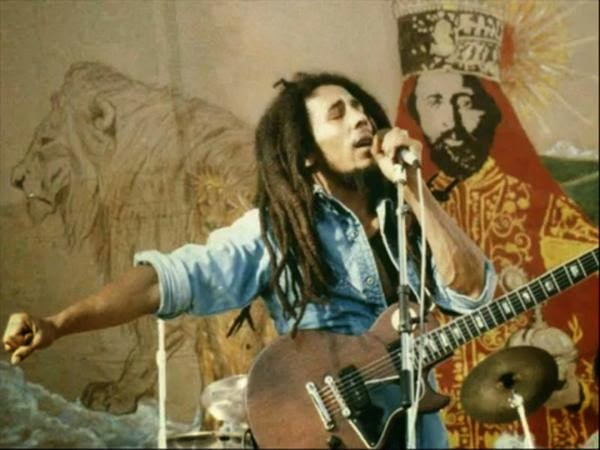 "Bob Marley's Top 9 Inspirational Quotes: ""Better to die fighting for freedom then to be a prisoner all the days of your life."" - Bob Marley"