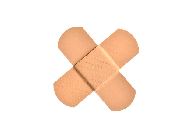 Two Band Aids Formed Into an X