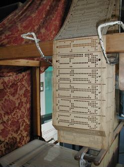 Close-up view of the punch cards used by Jacquard loom on display at the museum of science and industry. Photograph taken by George H. Williams in July, 2004.
