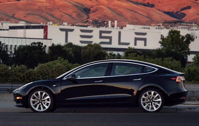 Elon Musk revealed Tesla Model 3 production unit one photos