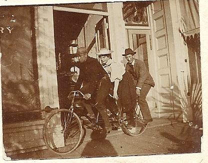 Three people on a bike