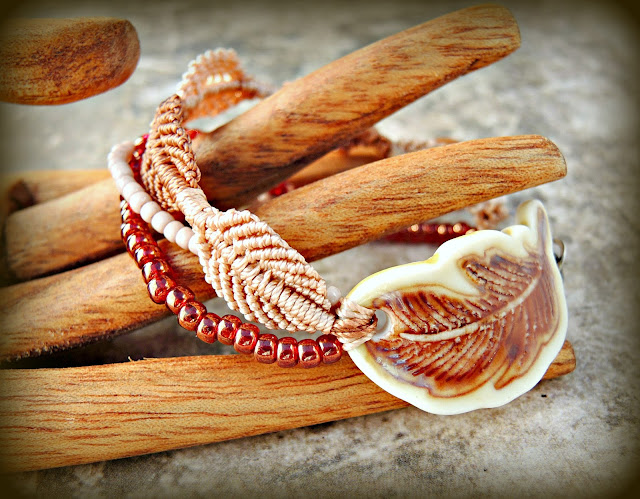 Micro macrame bracelet by Sherri Stokey with porcelain feather by Majoyoal.