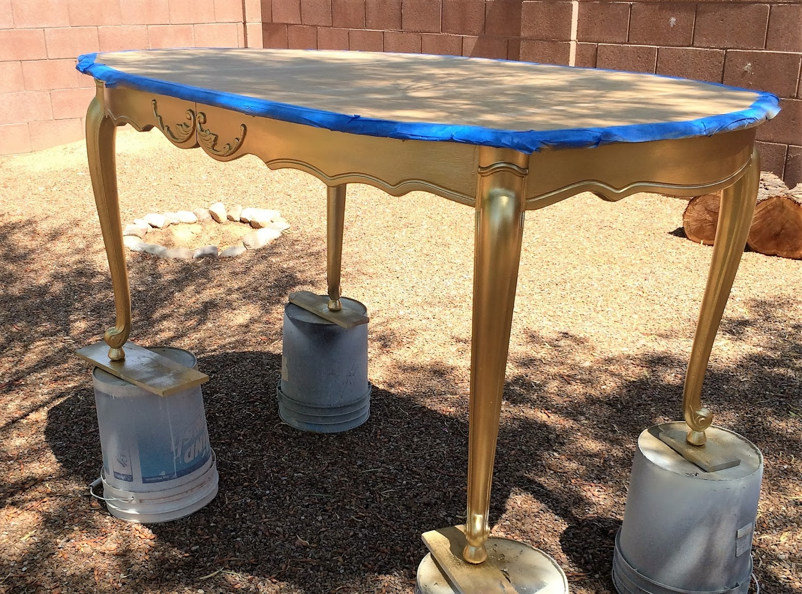 With the edges taped off and a few broken down cardboard boxes laying on  the top of the table  I really didn t want to get any paint on my fresh  clean table  Antique Gold Dining Table   A Ray of Sunlight. Dining Table Painted Gold. Home Design Ideas