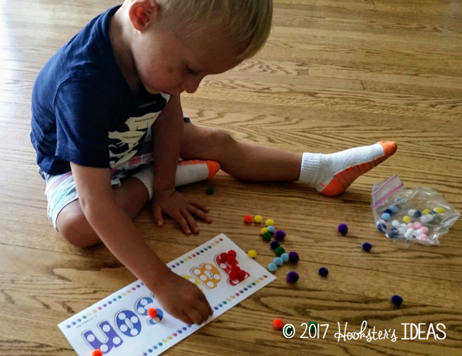 Learn how to sort colors by using your child's name and colored pom poms!