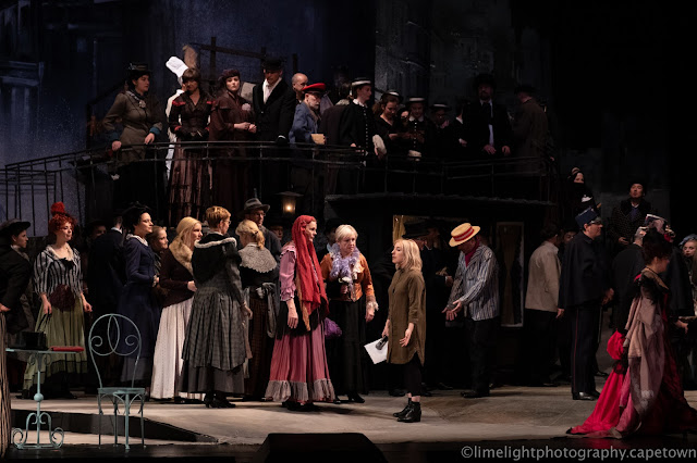 Chorus rehearsal onstage ,  Act 2 of Puccini's La Boheme - Victoria Stevens at Nationaltheater Mannheim