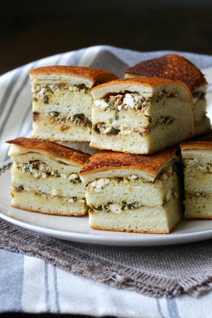 Tootmanik s Gotovo Testo is a Bulgarian cheese bread. Several layers of bread dough are brushed with butter and spread with feta cheese along with herbs, and then baked into savory and delicious stacks of deliciousness.