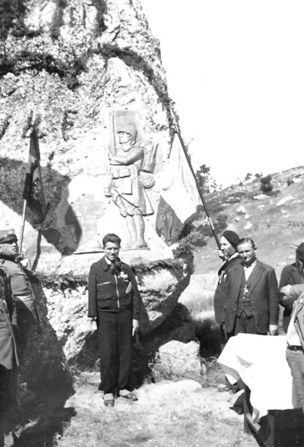 Marcel Ganguilhem with the monument