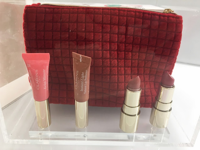 A red makeup bag, with several lip products