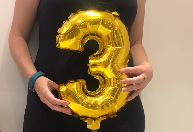 Holding a number 3 balloon next to my belly