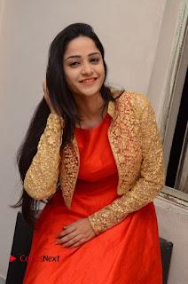 Telugu Actress Divya Nandini Stills in Orange Sleeveless Gown at Chennai Chaitrama Movie le Launch Event  0110.JPG