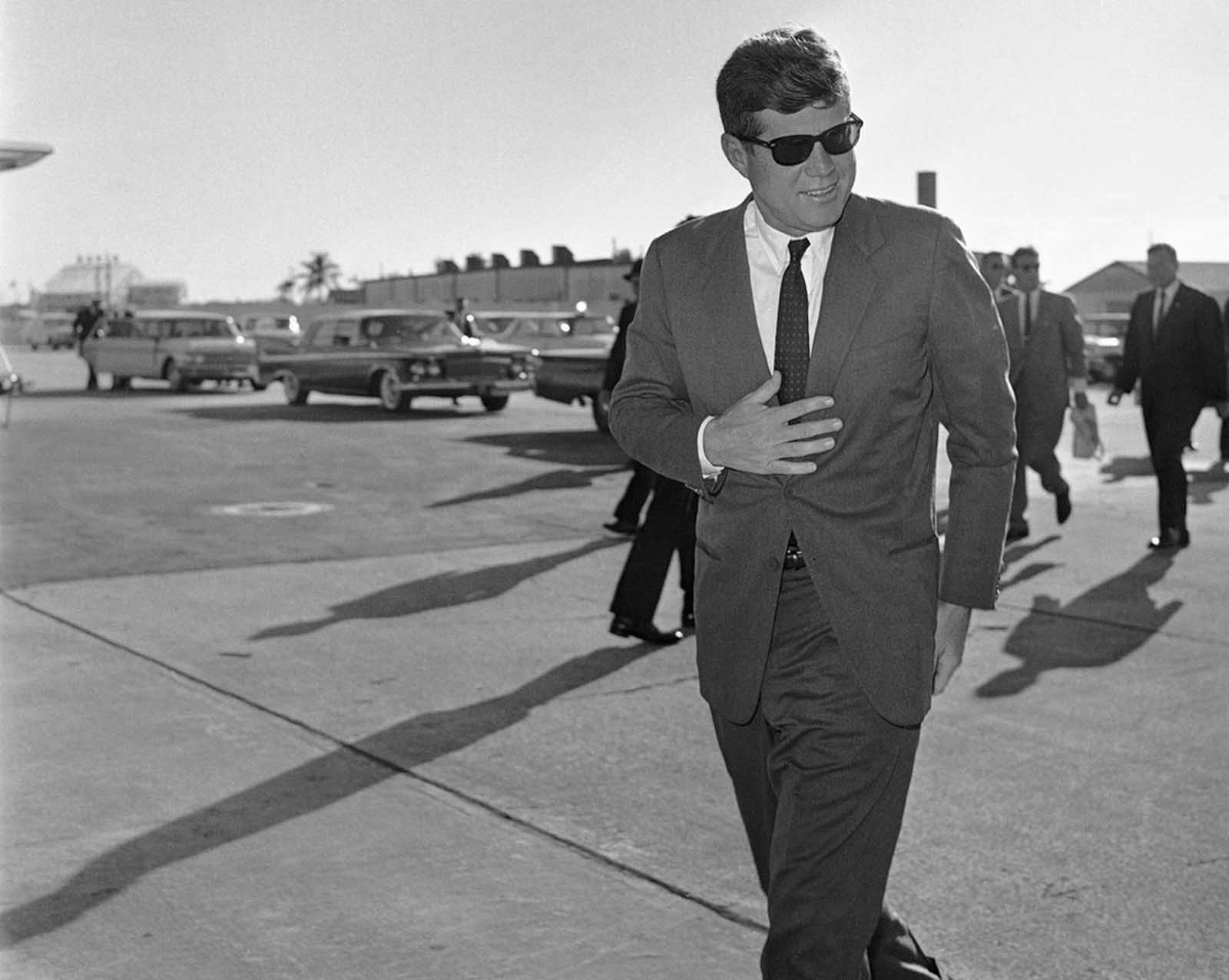 President John F. Kennedy heads for Washington after an overnight stopover on December 18, 1961 in West Palm Beach, Florida where he rested after his Latin American tour due to a heavy cold.