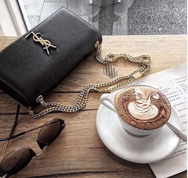 picture of a classic YSL bag with a gold chain and a hot chocolate