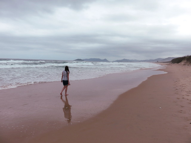 Walking peacefully and appreciating the view in Joaquina beach.