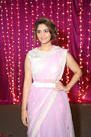 Surabhi in Designer Pink Saree and White Sleeveless Choli at Zee Telugu Apsara Awards 2017 04.JPG