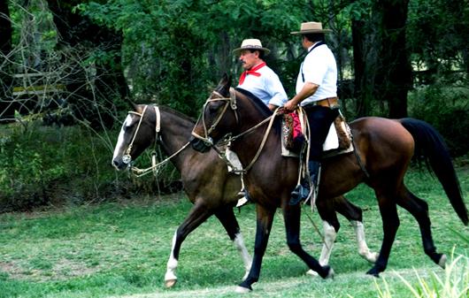 Gauchos on horseback in San Antonio de Areco, Argentina