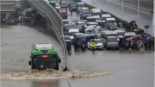 Passenger bus wading through flood