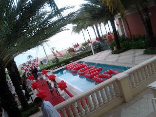 Swimming Pool party with red carpet and Step and Repeat bunner