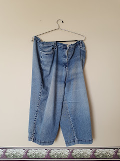 Worn denim capris