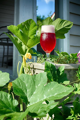 "Hibiscus NEIPA next to our ""wild"" pumpkin patch."