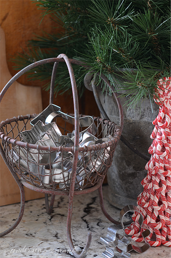 Antique mining basket filled with Christmas cookie cutters | www.andersonandgrant.com