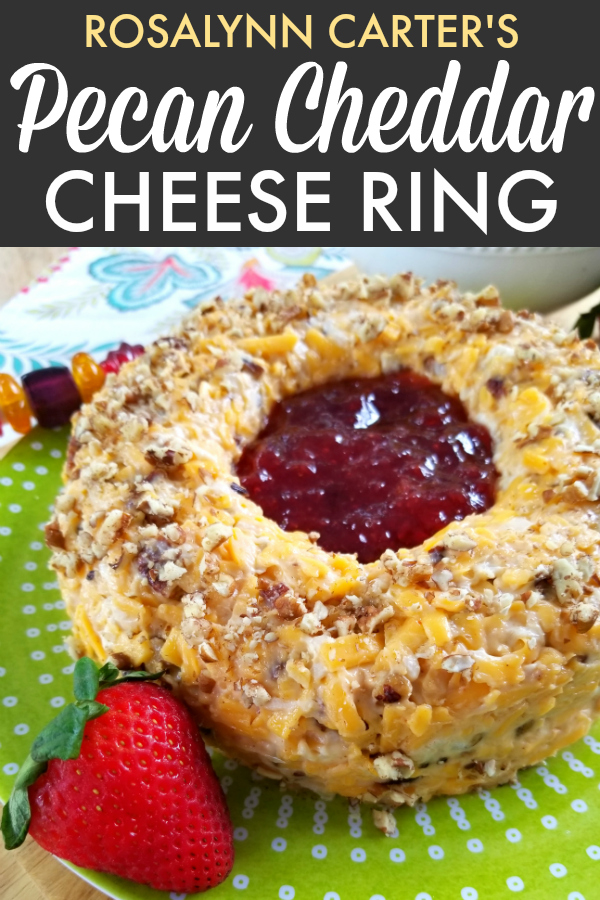 Rosalynn Carter's vintage appetizer recipe for a pecan and cheddar cheese ring with a slight hint of heat with strawberry preserves in the center served with crackers.