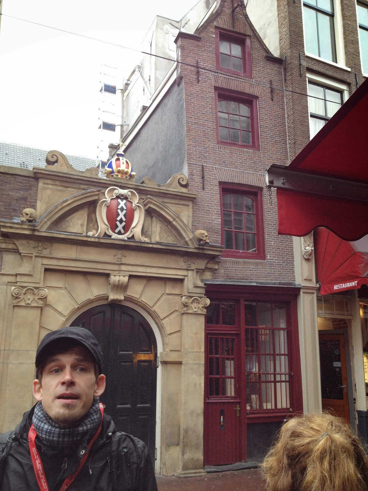 Amsterdam - Our tour guide shows us the smallest house in Amsterdam