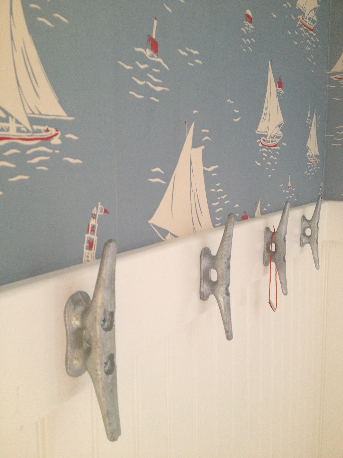 This Old Coconut Grove: cabana bathroom wallpaper & boat cleats