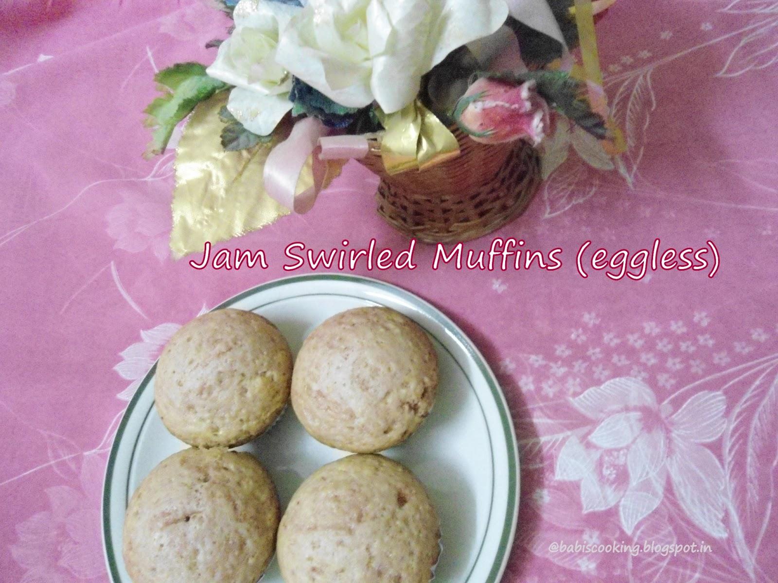 Eggless jam swirled muffins
