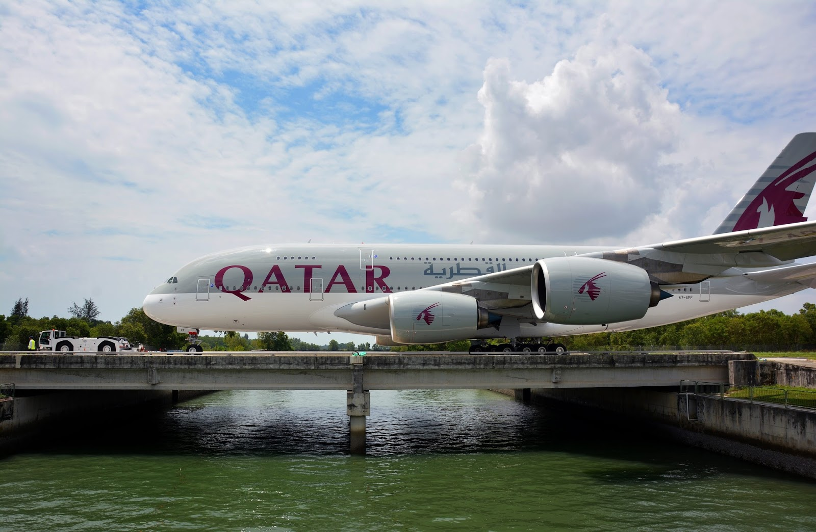 qatar airways airbus a380800 is being towed in singapore
