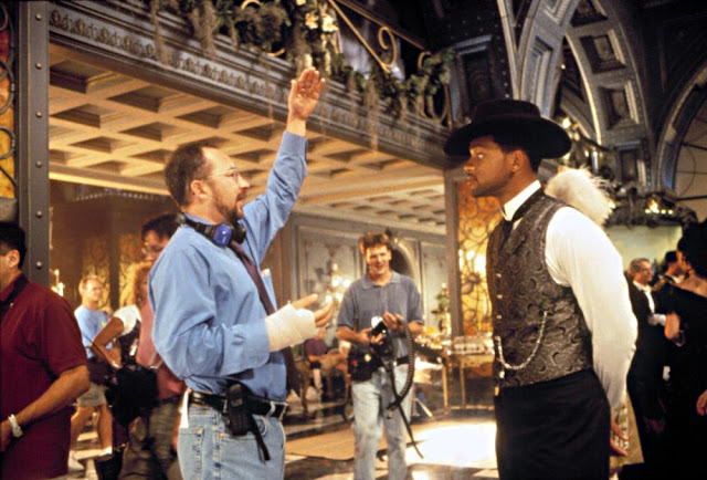 Director Barry Sonnenfeld and Will Smith on the set of Wild Wild West. Barry's hand in a cast, broken after hitting Will in the shoulder