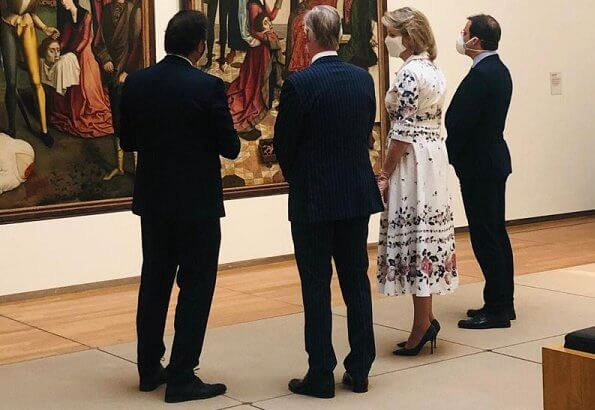 During her visit to the Old Masters Museum, Queen Mathilde wore a new floral print cotton shirt dress by Erdem