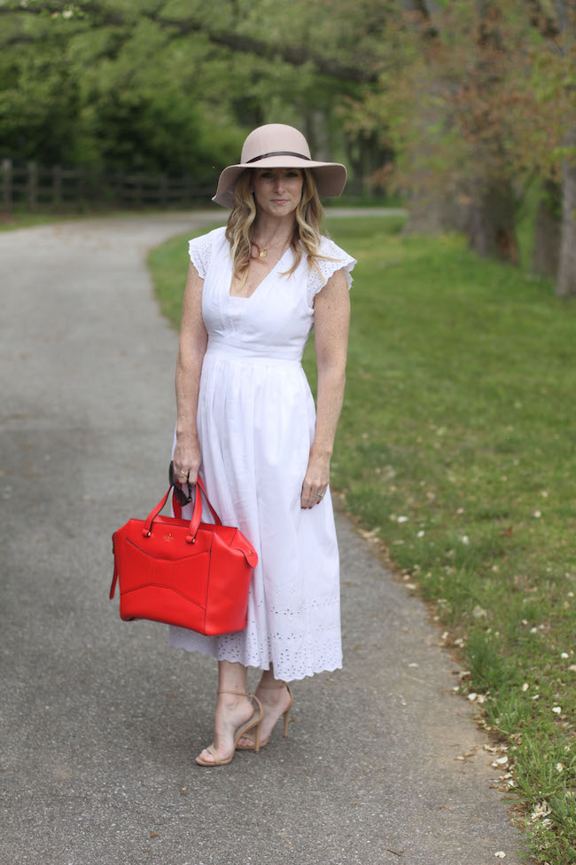 floppy hat, white summer dress, red tote bag