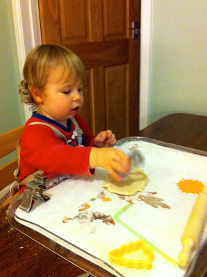 child using pastry cutters